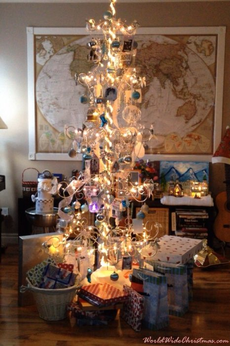 Silver metal christmas tree with throwback photos (Canada)
